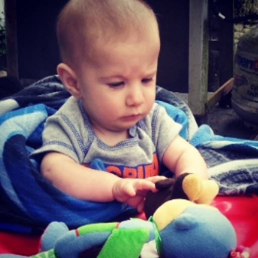 Baby Logan playing with toys