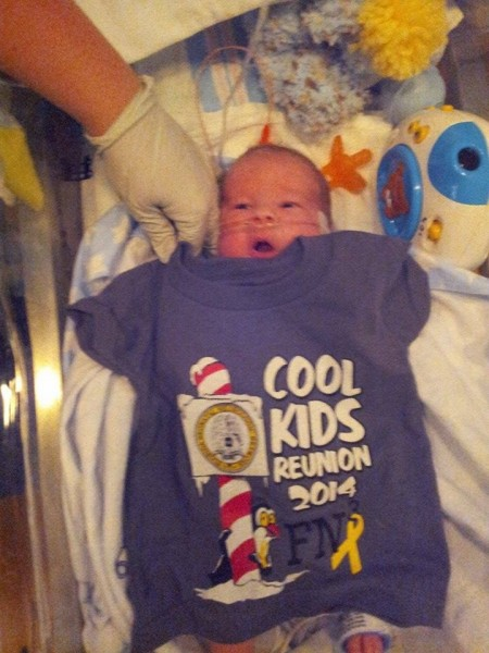 Baby Logan in the hospital wearing a Dr. Seuss tshirt
